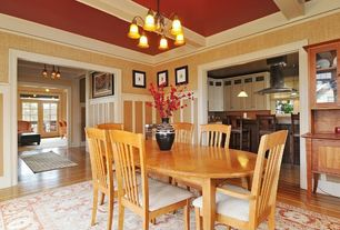 Traditional Dining Room with Laminate floors, Crown molding, Wainscotting, High ceiling, Exposed beam, Chandelier