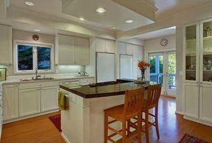 Traditional Kitchen with Glass panel, can lights, Drop-in sink, partial backsplash, Multiple Refrigerators, Casement