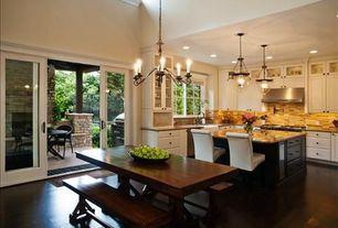 Traditional Great Room with Hardwood floors, sliding glass door, Pendant light, High ceiling, Casement, can lights