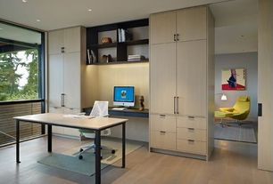 Contemporary Home Office with Built-in bookshelf, Laminate floors
