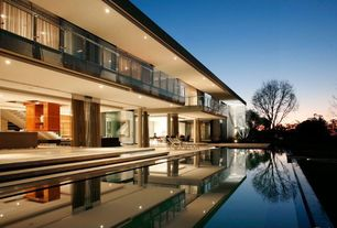 Modern Swimming Pool with Lap pool, Infinity pool, Pathway, Indoor/outdoor living, Glass railing