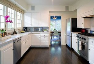 Contemporary Kitchen with U-shaped, Simple granite counters, Custom hood, Pinted wood cabinet, Farmhouse sink, Pergo, Flush