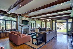 Traditional Living Room with French doors, Exposed beam, Linon Athena Rug, Hardwood floors, stone fireplace, Crown molding