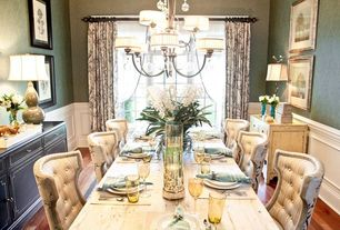 Traditional Dining Room with interior wallpaper, Crown molding, Wainscotting, High ceiling, Casement, Chandelier