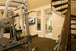 Traditional Home Gym with French doors, Carpet, Transom window, High ceiling