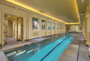 Traditional Swimming Pool with Indoor pool, exterior stone floors, French doors