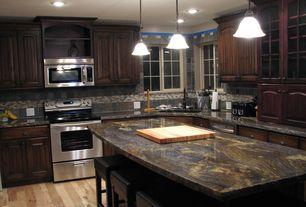 Traditional Kitchen with gas range, Flush, Kitchen island, full backsplash, Slate Tile, Standard height, Casement, can lights