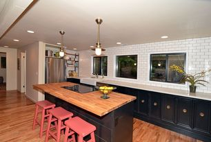 Country Kitchen with Wood counters, Corian counters, Farmhouse sink, Large Ceramic Tile, L-shaped, Flat panel cabinets