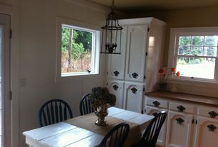 Cottage Kitchen with French doors, Breakfast nook, Flat panel cabinets, Crown molding, Chandelier, Wood counters, One-wall