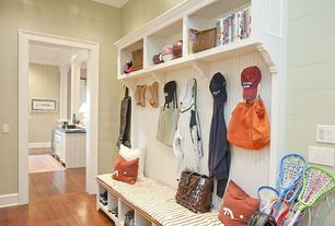 Traditional Entryway with Wainscotting, Hardwood floors, Built-in bookshelf, Mudroom, Built in storage bench, Crown molding