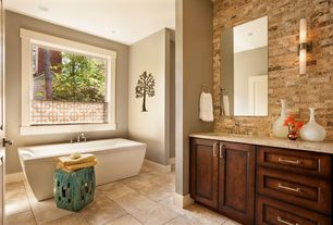 Contemporary Master Bathroom with Travertine split face linear tile, Freestanding soaking tub, Wall sconce, Undermount sink
