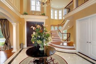 Traditional Entryway with Columns, Chandelier, Concrete tile , Standard height, Wainscotting, Carpet, Crown molding