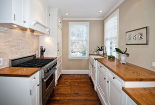 Traditional Kitchen with Hardwood floors, Stone Tile, Custom hood, Farmhouse sink, Wood counters, Flat panel cabinets