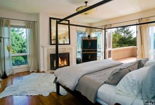 Contemporary Master Bedroom with Fireplace, flush light, Paint, Tiled stone fireplace surround, Standard height, Casement