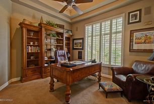 Traditional Home Office with Ceiling fan, picture window, High ceiling, Carpet, Built-in bookshelf