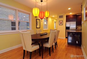 Modern Dining Room with can lights, Pendant light, double-hung window, Hardwood floors, Standard height
