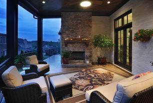 Modern Porch with stone fireplace, Transom window, flush light, French doors, terracotta tile floors