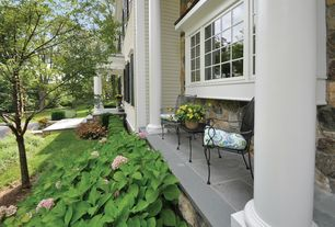 Traditional Porch with exterior stone floors, Wrap around porch, Pathway