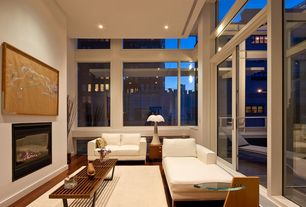 Contemporary Living Room with Table lamp, picture window, Fireplace, Coffee table, Strata rug, Neutral area rug, Sofa