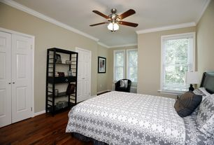 Modern Guest Bedroom with Crown molding, Ceiling fan, Hardwood floors, flush light