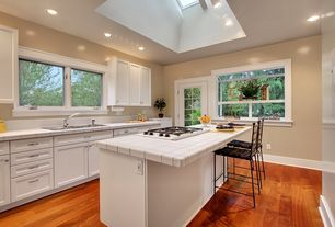 Traditional Kitchen with Large Ceramic Tile, electric cooktop, can lights, Box ceiling, Flush, Kitchen island, Skylight