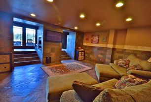 Craftsman Basement with stone tile floors, Standard height, can lights, picture window, slate tile floors