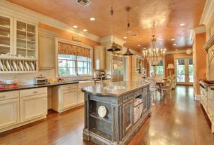 Traditional Kitchen with Flat panel cabinets, Soapstone counters, Large Ceramic Tile, Glass panel, Standard height, Casement