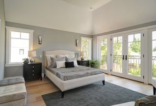 Traditional Master Bedroom with High ceiling, Hardwood floors, Carpet, Wall sconce