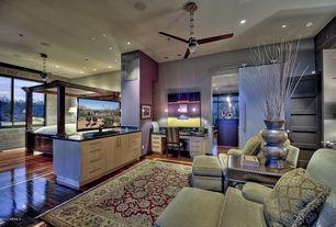 Eclectic Great Room with High ceiling, Built-in bookshelf, specialty door, six panel door, can lights, Hardwood floors