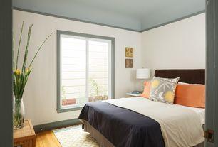 Modern Guest Bedroom with Casement, Bamboo floors, Standard height