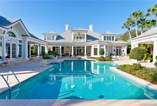 Traditional Swimming Pool with Lap pool, exterior tile floors, French doors, Bay window, Arched window, Transom window