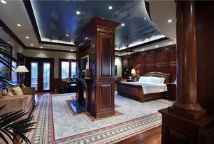 Traditional Guest Bedroom with Hardwood floors, Ceiling fan, High ceiling, Hardwood flooring, Louvered door, Wainscotting