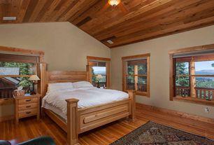 Craftsman Guest Bedroom with double-hung window, Standard height, Ceiling fan, Hardwood floors, Carpet