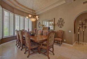 Mediterranean Dining Room with Standard height, terracotta tile floors, Pendant light, Casement