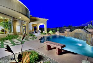 Mediterranean Swimming Pool with exterior stone floors, Raised beds, Infinity pool, French doors