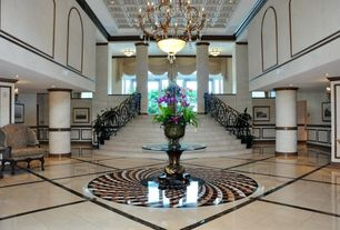 Traditional Staircase with flush light, picture window, Chandelier, stone tile floors, High ceiling, can lights, Columns