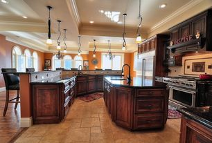 Traditional Kitchen with Undermount sink, Soapstone counters, Flat panel cabinets, Crown molding, Arched window, L-shaped