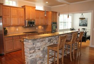 Traditional Kitchen with double wall oven, Pendant light, Hardwood floors, Breakfast nook, Transom window, Ceramic Tile
