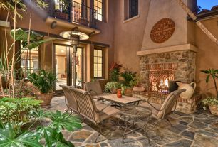 Mediterranean Patio with Casement, Fire pit, French doors, Deck Railing, exterior stone floors