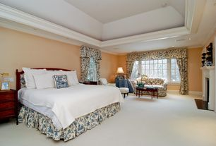 Traditional Master Bedroom with Window seat, High ceiling, Carpet, stone fireplace, Wainscotting, Crown molding, French doors
