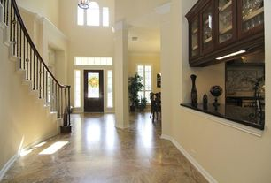 Traditional Hallway with Sunken living room, Crown molding, High ceiling, Arched window, Concrete tile , Built-in bookshelf
