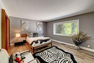 Eclectic Guest Bedroom with Hardwood floors