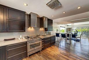 Contemporary Great Room with Standard height, Raised panel, Hardwood floors, Kitchen island, sliding glass door, Wall Hood