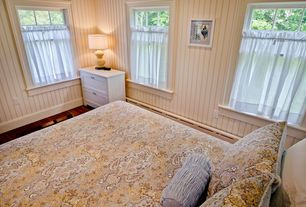 Cottage Guest Bedroom with Hardwood floors