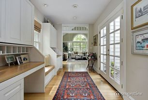 Traditional Hallway with French doors, Built-in bookshelf, Transom window, Laminate floors, Carpet, Window seat