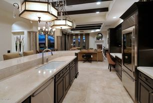 Contemporary Kitchen with Galley, Chandelier, Simple marble counters, High ceiling, Breakfast bar, specialty door