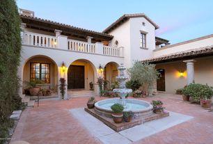 Mediterranean Patio with Fence, Deck Railing, Casement, exterior tile floors, Fountain, exterior herringbone tile floors