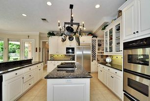 Traditional Kitchen with Raised panel, U-shaped, Simple granite counters, can lights, full backsplash, built-in microwave