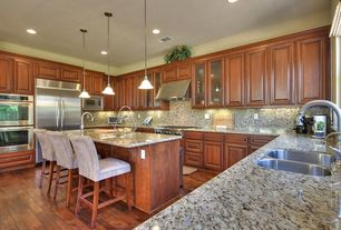Traditional Kitchen with Simple granite counters, Raised panel, Dura Supreme Cabinetry Venice Panel, Undermount sink