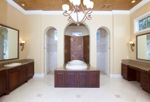 Mediterranean Master Bathroom with drop in bathtub, Casement, Wall sconce, Simple Granite, Chandelier, drop-in sink, Shower